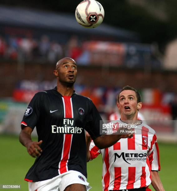 Derry City's Kevin McHugh with Paris Saint Germain's Sammy Traroe during the UEFA Cup first round first leg match at the Brandywell Stadium Derry