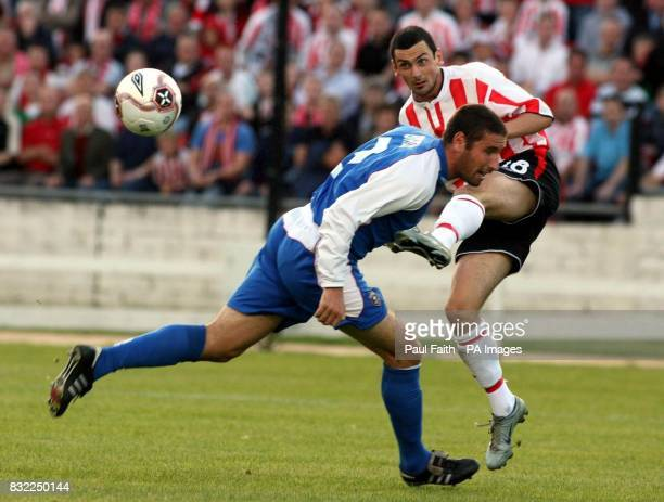 Derry City's Mark Farren clears the ball from Greta's Mark Birch during the UEFA Cup second qualifying round second leg match at the Brandywell...
