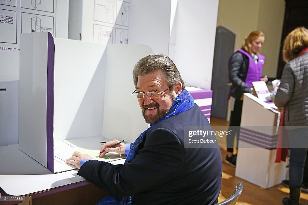 Derry Hinch, a candidate for the senate representing Victoria as the head of 'Derryn Hinch's Justice Party' casts his vote in the national election at a polling station at Albert Park Primary School on July 2, 2016 in Melbourne, Australia. Voters head to the polls today to elect the 45th parliament of Australia.