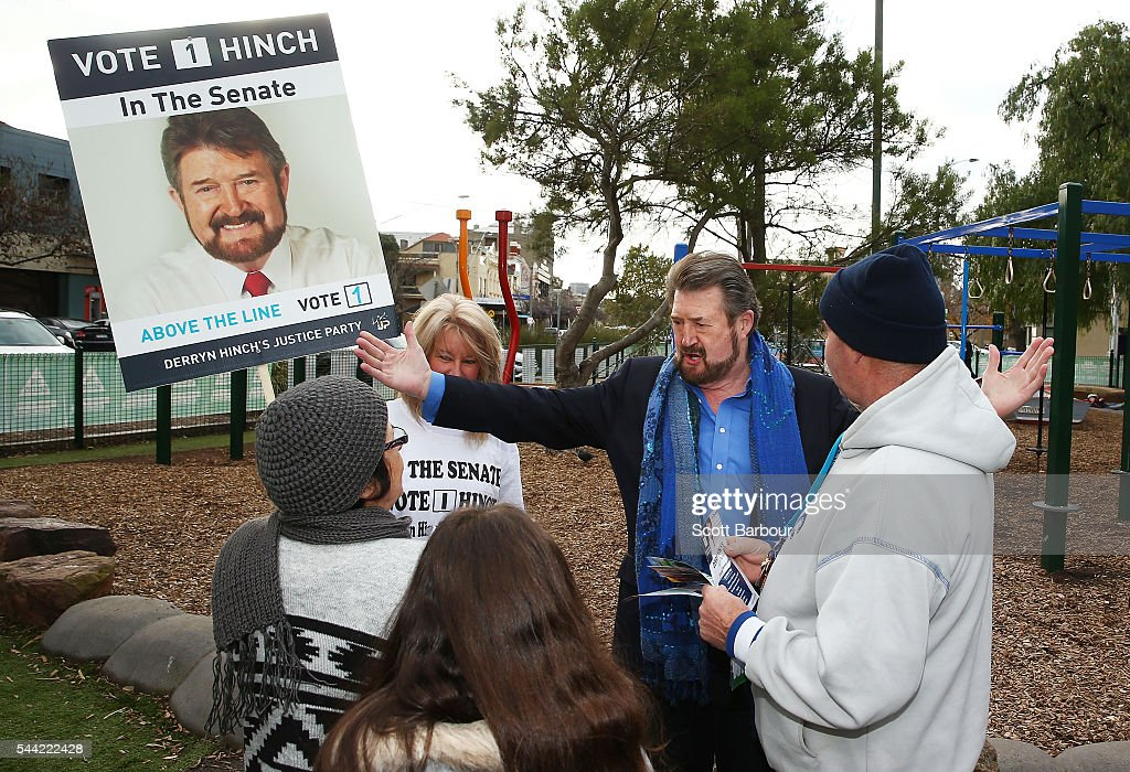 Derry Hinch, a candidate for the senate representing Victoria as the head of 'Derryn Hinch's Justice Party' greets supporters as he arrives to vote in the national election at a polling station at Albert Park Primary School on July 2, 2016 in Melbourne, Australia. Voters head to the polls today to elect the 45th parliament of Australia.