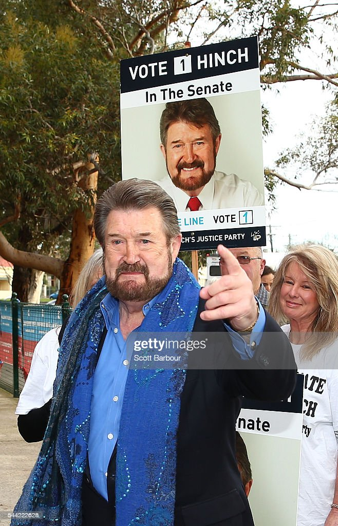 Derry Hinch, a candidate for the senate representing Victoria as the head of 'Derryn Hinch's Justice Party' arrives to vote in the national election at a polling station at Albert Park Primary School on July 2, 2016 in Melbourne, Australia. Voters head to the polls today to elect the 45th parliament of Australia.