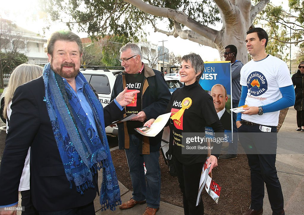 Derry Hinch, a candidate for the senate representing Victoria as the head of 'Derryn Hinch's Justice Party' is handed voting information by Meredith Doig of the Australian Sex Party he arrives to vote in the national election at a polling station at Albert Park Primary School on July 2, 2016 in Melbourne, Australia. Voters head to the polls today to elect the 45th parliament of Australia.