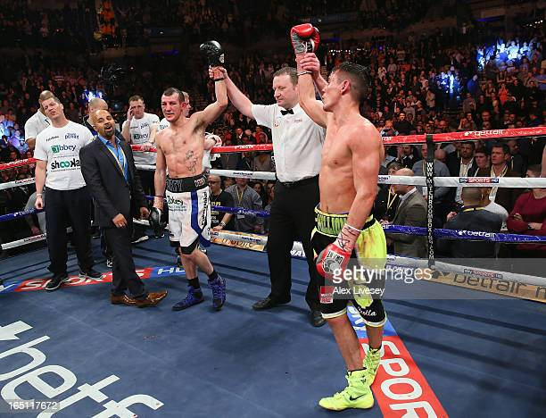 Derry Mathews of Liverpool and Anthony Crolla of Manchester look dejected after the judges decide on a draw after their Vacant Commonwealth...