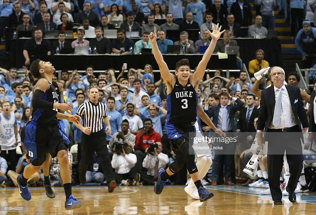 Derryck Thornton #12 watches as teammate Grayson Allen #3 of the Duke Blue Devils celebrates after defeating the North Carolina Tar Heels 74-73 as head coach Roy Williams watches on during their game at Dean Smith Center on February 17, 2016 in Chapel Hill, North Carolina.