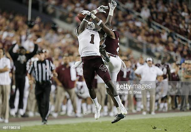 De'Runnya Wilson of the Mississippi State Bulldogs has his pass broken up by Brandon Williams of the Texas AM Aggies in the second half on October 3...