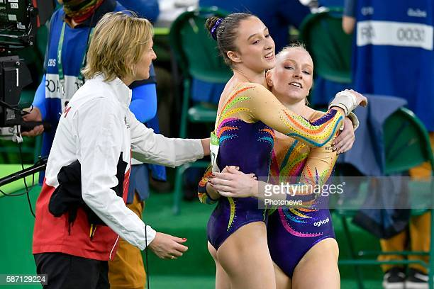 Derwael Nina and Mys Gaelle of Belgium embrace in the Artistic Gymnastics Women's Team qualification during the Rio 2016 Summer Olympic Games on...