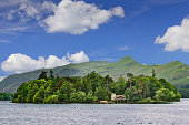 Derwent Water and Mountains, Keswick, Lake District, England. The Lake District, also known as The Lakes or Lakeland, is a mountainous region in North West England. A popular holiday destination, it i
