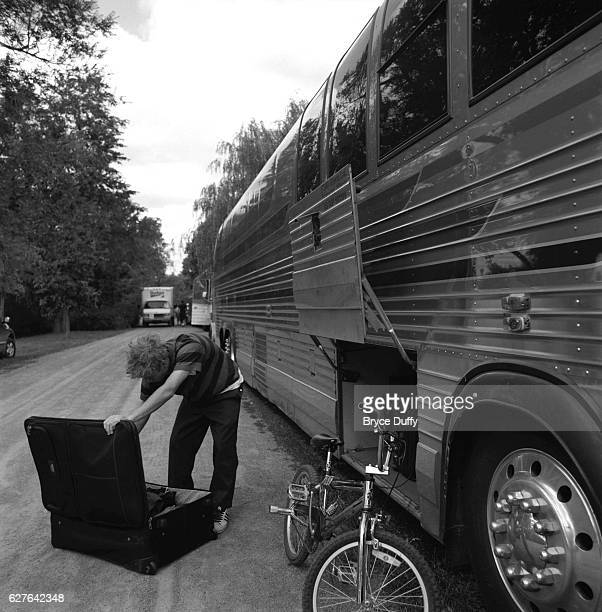 Deryck Whibley looks through one of his suitcases on the side of the Sum 41's tour bus Sum 41 is on the road and peforming concerts in their native...