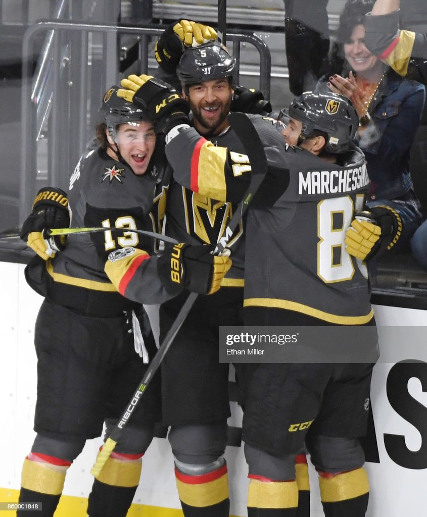 Deryk Engelland (C) #5 of the Vegas Golden Knights celebrates with teammates Brendan Leipsic #13 and Jonathan Marchessault #81 after Engelland scored a first-period goal against the Arizona Coyotes during the Golden Knights' inaugural regular-season home opener at T-Mobile Arena on October 10, 2017 in Las Vegas, Nevada. The Golden Knights won 5-2.