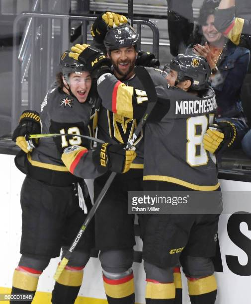 Deryk Engelland of the Vegas Golden Knights celebrates with teammates Brendan Leipsic and Jonathan Marchessault after Engelland scored a firstperiod...