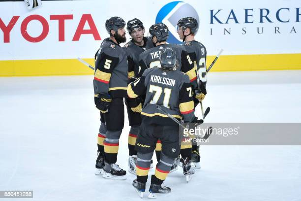 Deryk Engelland David Perron Shea Theodore William Karlsson and Cody Eakin of the Vegas Golden Knights celebrate after scoring a goal against the San...