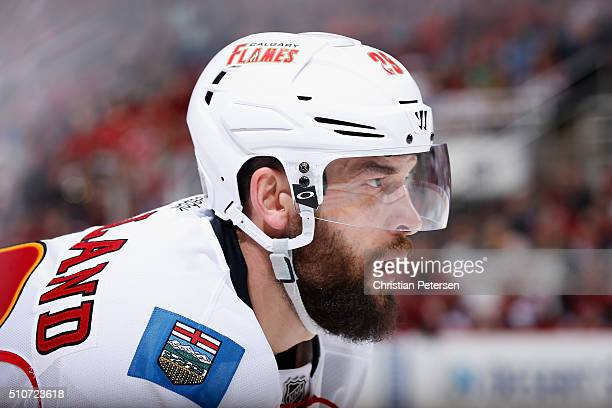 Deryk Engelland of the Calgary Flames awaits a face off against the Arizona Coyotes during the NHL game at Gila River Arena on February 12 2016 in...