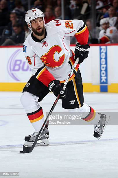 Deryk Engelland of the Calgary Flames controls the puck against the Colorado Avalanche at Pepsi Center on November 3 2015 in Denver Colorado The...