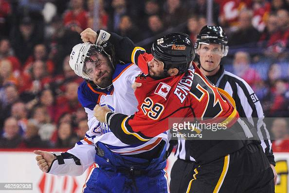 Deryk Engelland of the Calgary Flames fights Luke Gazdic of the Edmonton Oilers during an NHL game at Scotiabank Saddledome on January 31 2015 in...