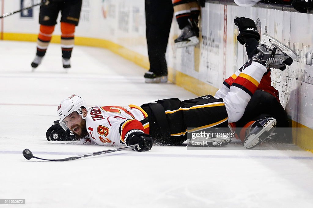 Deryk Engelland #29 of the Calgary Flames lunges for a loose puck during the second period of a game agains the Anaheim Ducks at Honda Center on February 21, 2016 in Anaheim, California.