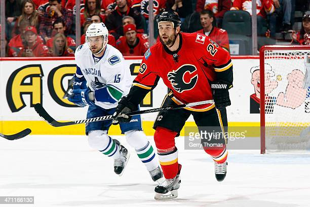 Deryk Engelland of the Calgary Flames skates against Brad Richardson of the Vancouver Canucks at Scotiabank Saddledome for Game Six of the Western...