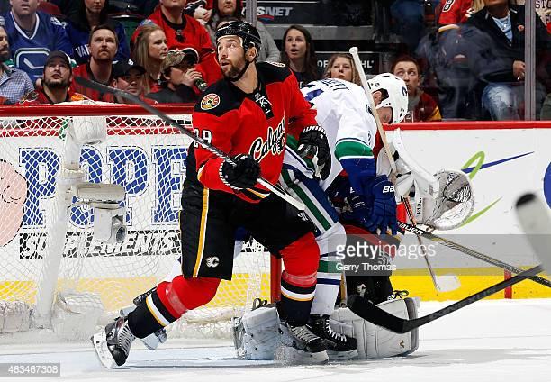 Deryk Engelland of the Calgary Flames skates against Derek Dorsett of the Vancouver Canucks at Scotiabank Saddledome on February 14 2015 in Calgary...