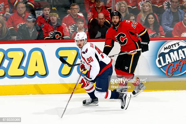 Deryk Engelland of the Calgary Flames skates against Marcus Johansson of the Washington Capitals during an NHL game on October 30 2016 at the...