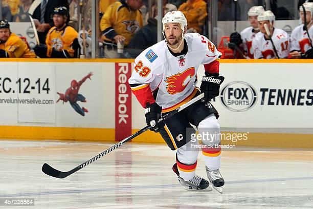 Deryk Engelland of the Calgary Flames skates against the Nashville Predators at Bridgestone Arena on October 14 2014 in Nashville Tennessee