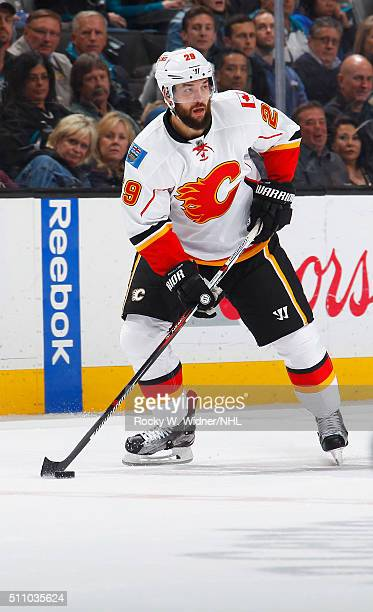 Deryk Engelland of the Calgary Flames skates with the puck against the San Jose Sharks at SAP Center on February 11 2016 in San Jose California