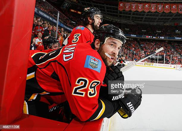 Deryk Engelland of the Calgary Flames watches on against the Dallas Stars at Scotiabank Saddledome on March 25 2015 in Calgary Alberta Canada
