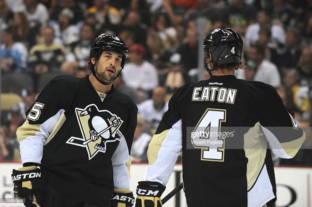Deryk Engelland (5) of the Pittsburgh Penguins and Mark Eaton (4) of the Pittsburgh Penguins against the New York Islanders in Game Two of the Eastern Conference Quarterfinals during the first period of the 2013 NHL Stanley Cup Playoffs at the CONSOL Energy Center in Pittsburgh, Pennsylvania on May 3, 2013.