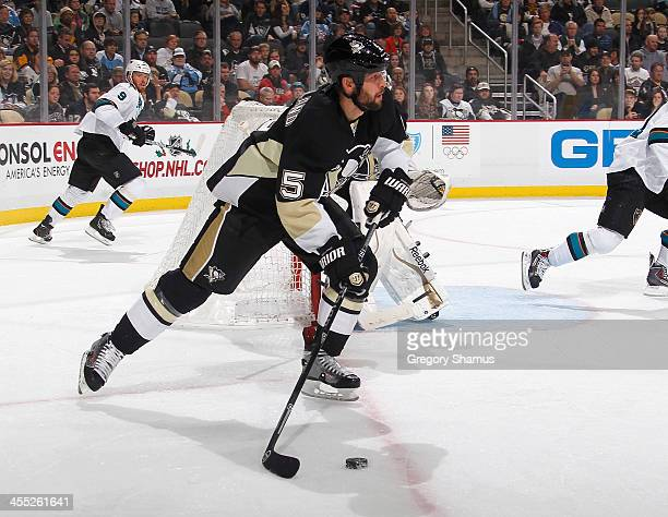 Deryk Engelland of the Pittsburgh Penguins moves the puck against the San Jose Sharks on December 5 2013 at Consol Energy Center in Pittsburgh...