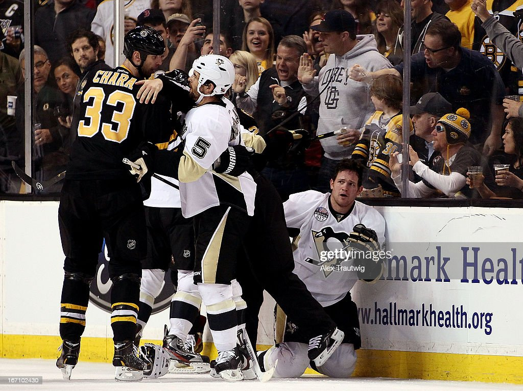 <a gi-track='captionPersonalityLinkClicked' href=/galleries/search?phrase=Deryk+Engelland&family=editorial&specificpeople=3390067 ng-click='$event.stopPropagation()'>Deryk Engelland</a> #5 of the Pittsburgh Penguins steps in front of Zdeno Chara #33 of the Boston Bruins after a check on <a gi-track='captionPersonalityLinkClicked' href=/galleries/search?phrase=Matt+Cooke&family=editorial&specificpeople=592551 ng-click='$event.stopPropagation()'>Matt Cooke</a> (R) #24 of the Pittsburgh Penguins at the TD Garden on April 20, 2013 in Boston, Massachusetts. The Penguins defeated the Bruins 3-2.