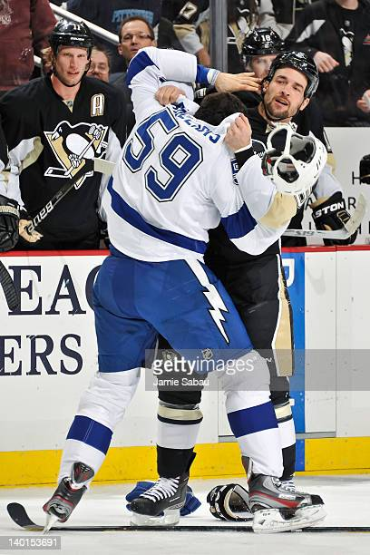 Deryk Engelland of the Pittsburgh Penguins wrestles with Mike Angelidis of the Tampa Bay Lightning on February 25 2012 at CONSOL Energy Center in...
