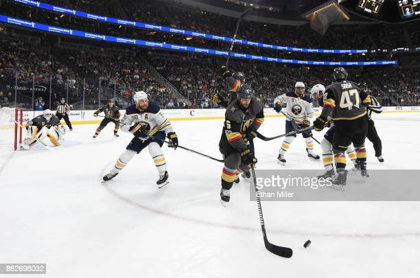 Deryk Engelland of the Vegas Golden Knights passes the puck against Ryan O'Reilly of the Buffalo Sabres in the third period of their game at TMobile...