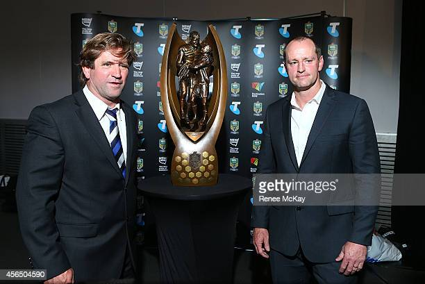 Des Hasler and Michael Maguire pose for a photo with the trophy during a press conference at the 2014 NRL Grand Final lunch at The Star on October 2...