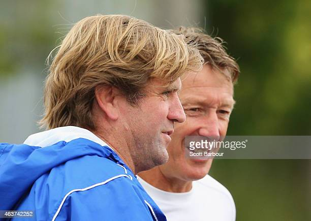 Des Hasler Bulldogs coach and Craig Bellamy coach of the Storm talk during a joint NRL training session with the Melbourne Storm and Canterbury...