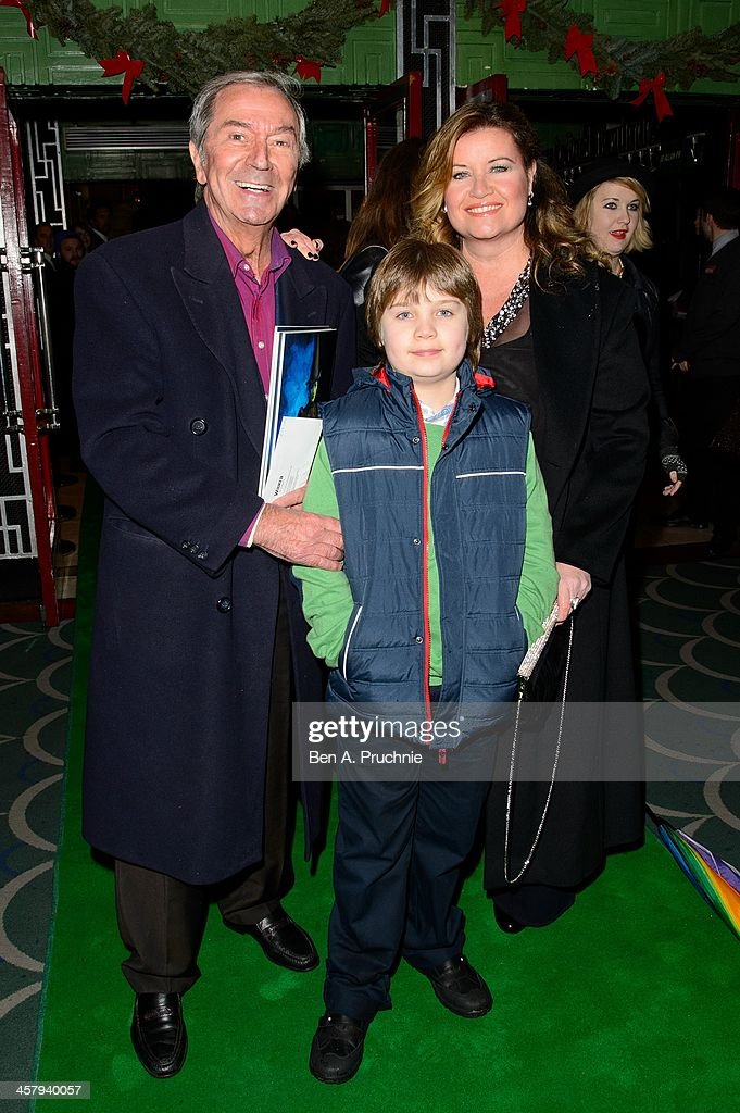 <a gi-track='captionPersonalityLinkClicked' href=/galleries/search?phrase=Des+O%27Connor&family=editorial&specificpeople=913881 ng-click='$event.stopPropagation()'>Des O'Connor</a>, Adam O'connor and Jodie Brooke Wilson attends the press night for 'Wicked' at Apollo Victoria Theatre on December 19, 2013 in London, England.