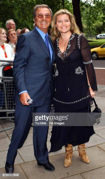 Des O'Connor and his wife Jodie arrive for the Ivor Novello Awards at the Grosvenor House hotel on Park Lane in central London The 48th annual music...