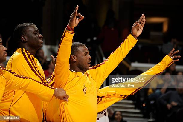 DeSagana Diop and Dion Waiters of the Cleveland Cavaliers react to a dunk by Tristan Thompson in the game against the Detroit Pistons at The Quicken...