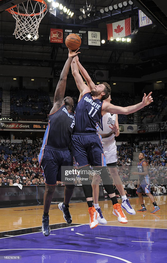 DeSagana Diop #2 and Josh McRoberts #11 of the Charlotte Bobcats rebound against the Sacramento Kings on March 3, 2013 at Sleep Train Arena in Sacramento, California.