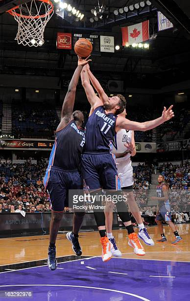 DeSagana Diop and Josh McRoberts of the Charlotte Bobcats rebound against the Sacramento Kings on March 3 2013 at Sleep Train Arena in Sacramento...