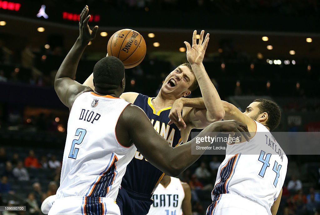 DeSagana Diop #2 of the Charlotte Bobcats and teammate Jeffery Taylor #44 try to stop Tyler Hansbrough #50 of the Indiana Pacers during their game at Time Warner Cable Arena on January 15, 2013 in Charlotte, North Carolina.