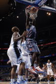 DeSagana Diop of the Charlotte Bobcats dunks against the Orlando Magic on October 14 2010 at Amway Center in Orlando Florida NOTE TO USER User...