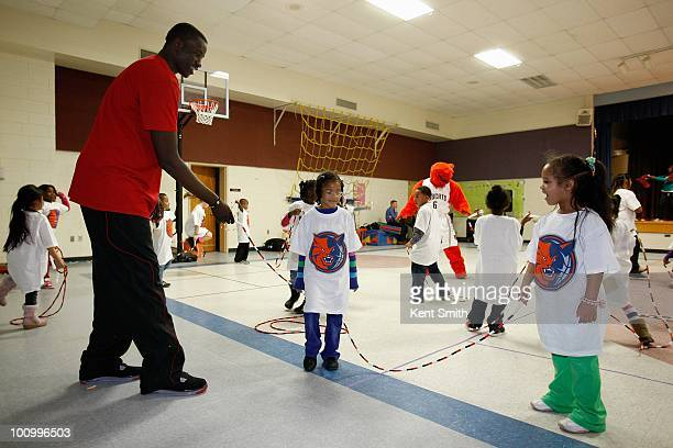 DeSagana Diop of the Charlotte Bobcats participates at the Bobcats Fitness Rally on January 19 2010 at University Meadows Elementary School in...