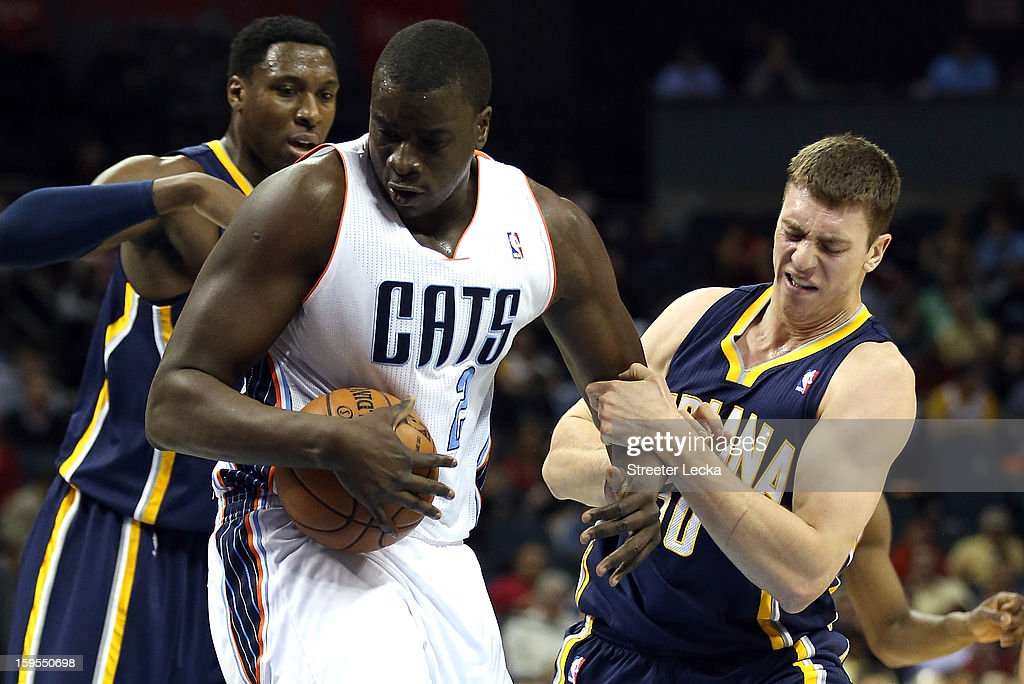 DeSagana Diop #2 of the Charlotte Bobcats rips the ball away from Tyler Hansbrough #50 of the Indiana Pacers during their game at Time Warner Cable Arena on January 15, 2013 in Charlotte, North Carolina.