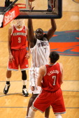 DeSagana Diop of the Charlotte Bobcats shoots against Ersan Ilyasova of the Milwaukee Bucks on December 26 2011 during the season opener at the Time...