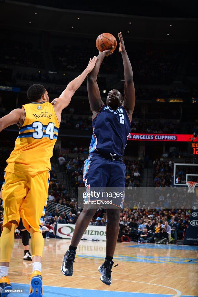 <a gi-track='captionPersonalityLinkClicked' href=/galleries/search?phrase=DeSagana+Diop&family=editorial&specificpeople=213233 ng-click='$event.stopPropagation()'>DeSagana Diop</a> #2 of the Charlotte Bobcats shoots against <a gi-track='captionPersonalityLinkClicked' href=/galleries/search?phrase=JaVale+McGee&family=editorial&specificpeople=4195625 ng-click='$event.stopPropagation()'>JaVale McGee</a> #34 of the Denver Nuggets on December 22, 2012 at the Pepsi Center in Denver, Colorado.