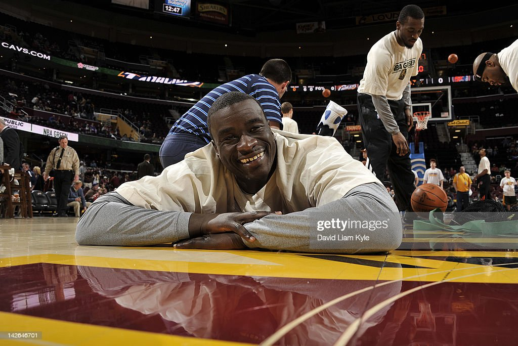 DeSagana Diop #7 of the Charlotte Bobcats smiles as he is stretched prior to the game against the Cleveland Cavaliers at The Quicken Loans Arena on April 10, 2012 in Cleveland, Ohio.