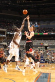 DeSagana Diop of the Charlotte Bobcats vies for the ball against Omer Asik of the Chicago Bulls during the game at the Time Warner Cable Arena on...
