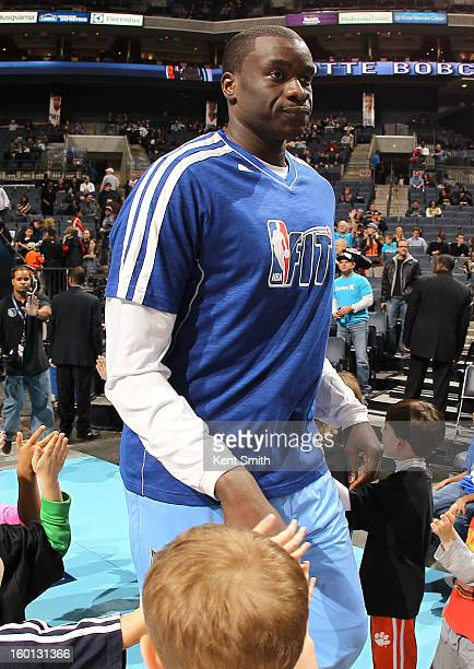 DeSagana Diop of the Charlotte Bobcats wears a Fit Tshirt before the game against the Minnesota Timberwolves at the Time Warner Cable Arena on...