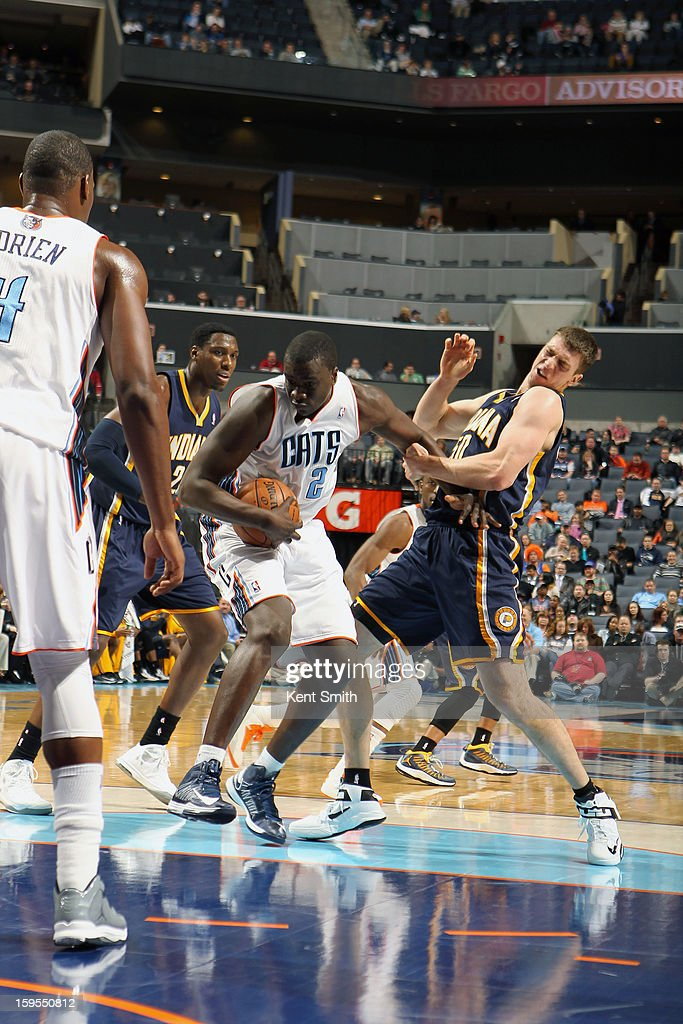 DeSagana Diop #2 of the Charlotte Bobcats wrestles for the ball against Tyler Hansbrough #50 of the Indiana Pacers at the Time Warner Cable Arena on January 15, 2013 in Charlotte, North Carolina.