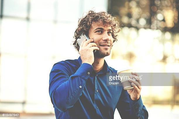 Desaturated image of charming young man with phone