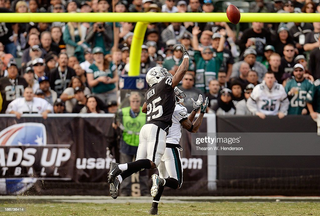 DeSean Jackson of the Philadelphia Eagles catches a fifty nine yard pass over DJ Hayden of the Oakland Raiders during the third quarter at Oco...