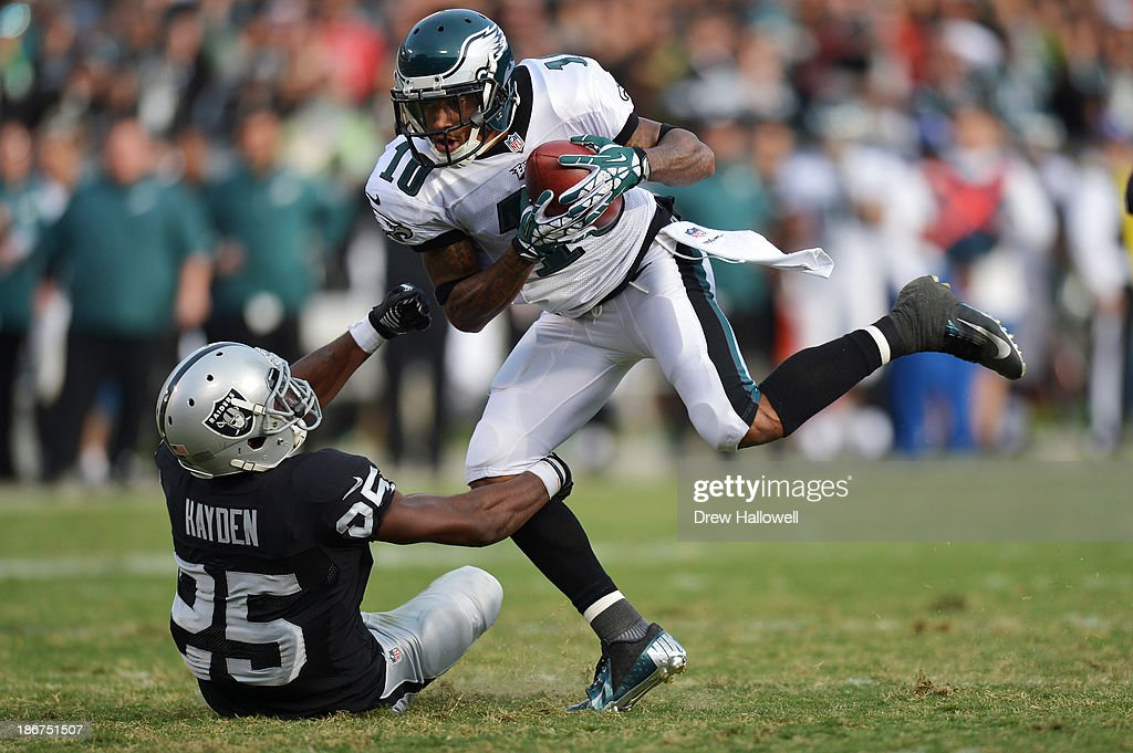 <a gi-track='captionPersonalityLinkClicked' href=/galleries/search?phrase=DeSean+Jackson&family=editorial&specificpeople=2212775 ng-click='$event.stopPropagation()'>DeSean Jackson</a> #10 of the Philadelphia Eagles catches a pass against <a gi-track='captionPersonalityLinkClicked' href=/galleries/search?phrase=D.J.+Hayden&family=editorial&specificpeople=8162990 ng-click='$event.stopPropagation()'>D.J. Hayden</a> #25 of the Oakland Raiders at O.co Coliseum on November 3, 2013 in Oakland, California. The Eagles won 49-20.